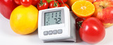 Blood pressure monitor and fruits with vegetables, healthy lifestyle