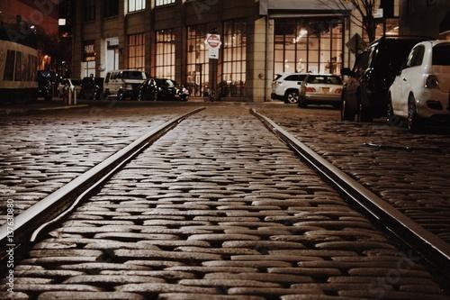 Tracks in Cobblestone Street Poster
