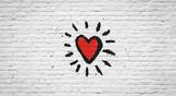 Coeur sur mur de briques