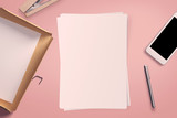 Top view of blank white paper sheet with office tools. Workspace mock up