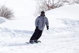 man snowboarding in winter