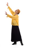 Senior woman is dancing. Old lady raising arms isolated.