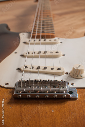 Poster Vintage Fender Stratocaster electric guitar bridge close up with magnets, maple