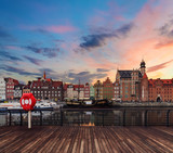 Background with wooden floors and Gdansk cityscape, during sunset. Poland