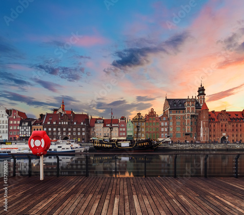 Staande foto Stockholm Background with wooden floors and Gdansk cityscape, during sunset. Poland