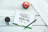 Digital marketing written on notebook