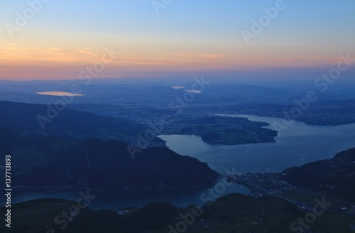 Lake Vierwaldstattersee and Lucerne just before sunrise Poster