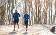 Young couple running in forest