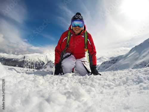 Skier with skiing equipment on mountain