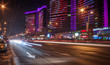 Moscow night cityscape with street traffic.