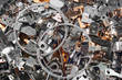 Pile of shiny metal parts. Scrap steel details as abstract industrial background.