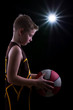 Young athlete poses with basketball
