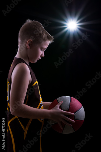 Fotobehang Basketbal Young athlete poses with basketball
