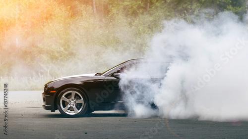 Drift - muscle car makes smoke - 137745248