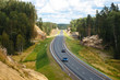 Hilly road in Karelia, the cars on the track