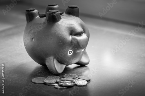 Poster Piggy bank upside down on table, financial problems and debt concept