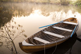 wooden boat on a lake at dawn