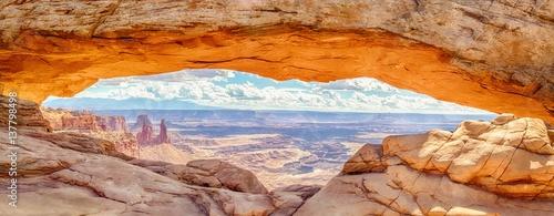 Poster Oranje eclat Mesa Arch panorama at sunrise, Canyonlands National Park, Utah, USA