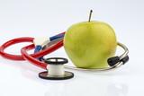 Apfel und Stethoskop