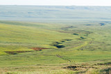 Steppe with breakages, track and hills, Republic of Kalmykia, Russia