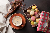 Coffee, chocolate and macaroons on old kitchen table