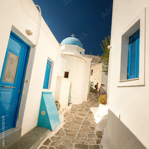 Traditional blue shutters on white buildings Paros