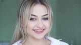 Pretty girl smiling to camera in 4K