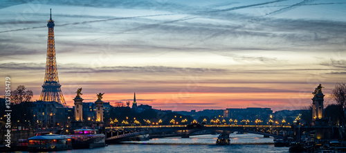 Paris cityscape with Tour Eiffel and Pont Alexandre III at twilight Photo by Marco Saracco