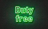 Duty free neon sign on brick wall background.