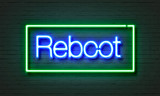 Reboot neon sign on brick wall background.