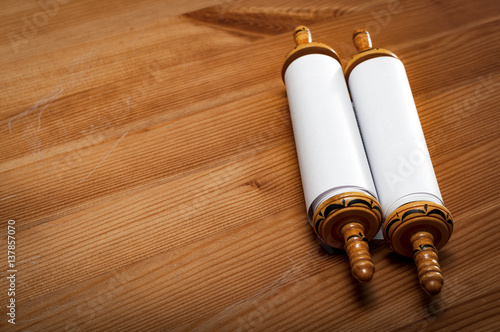 Plakát Judaism and religious text concept with a closed Torah on wooden background with