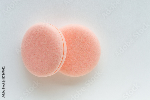 Poster cosmetic sponges on white background