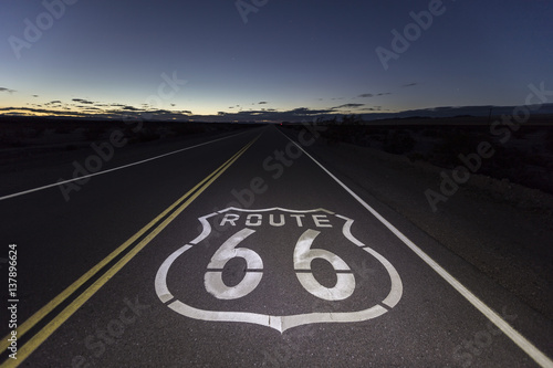 Foto op Plexiglas Route 66 Route 66 pavement sign at night in the Southern California Mojave desert.