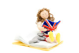 Doll with the book in hands a flag of England