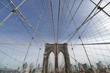 Perfect geometry of the Brooklyn Bridge cable web with overlook on Manhattan