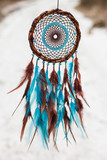 Fototapety Dreamcatcher made of feathers, leather, beads, and ropes