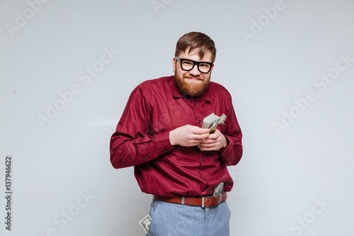 Poster Funny male nerd with money in hand