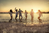 Silhouette of group young people on the beach. - Fine Art prints