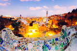 Barcelona, Spain. Park Guell and cityscape at sunset