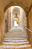old stone steps and arch in the medieval village, Pitigliano, tuscany, italy - 137968450