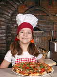 happy little girl cook with pizza in pizzeria