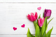 Tulip bouquet on white wooden background, copy space