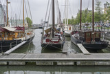 A view of on small old boats in a summer rainy day in the harbor of  Rotterdam.