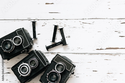 collection old  vintage retro photo cameras on white wooden background