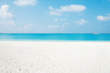 beautiful tranquil beach in blue sunny sky