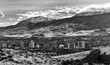 City of Reno Nevada during the winter with dramatic clouds and snow in monochrome.
