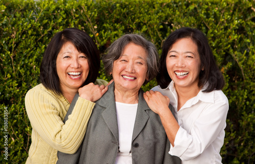Mature Asian mother and her adult daughters. Poster