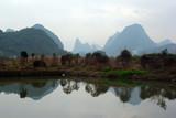 Foggy karst landscape near Yangshuo, Guangxi province, China.