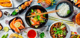 Asian food served on wooden table, top view