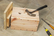 Ready birdhouse and tool lying on the floor  in the workshop